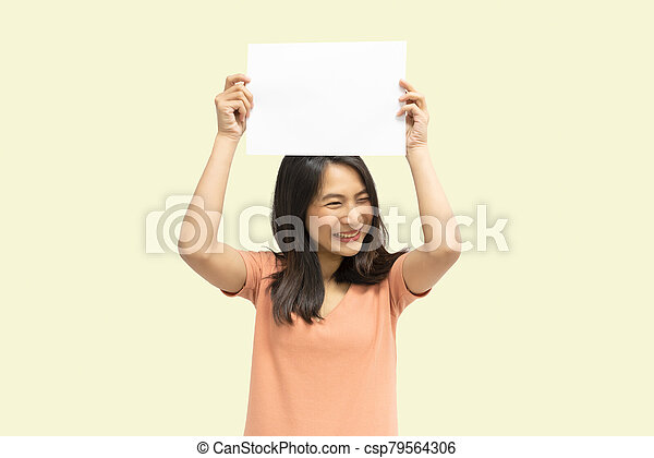 Woman showing blank white paper for copy space - csp79564306