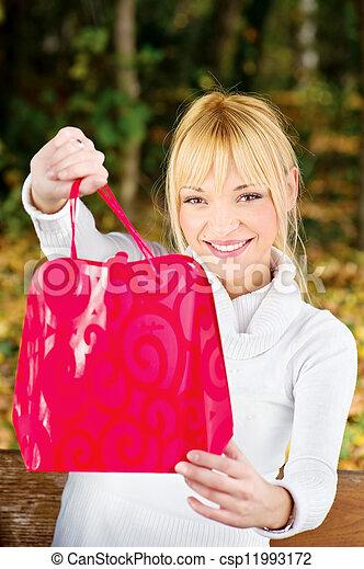 woman showing her shopping bag - csp11993172