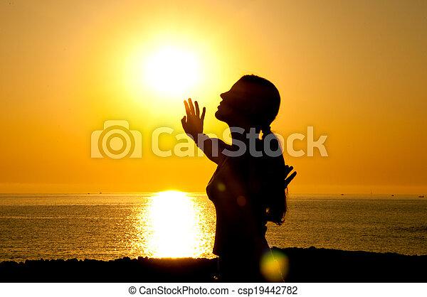 Woman silhouette in the sun - csp19442782