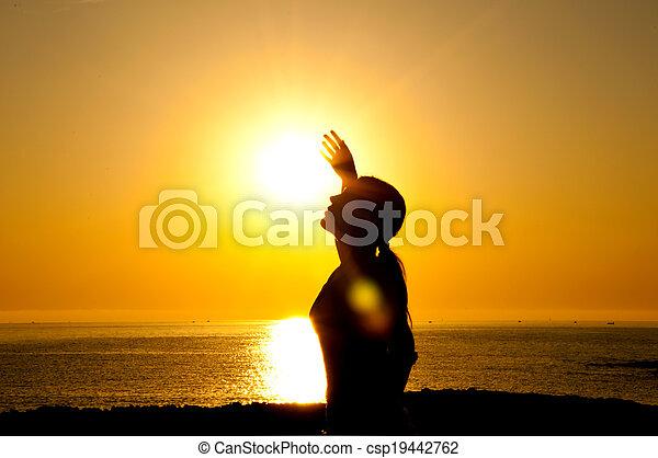 Woman silhouette in the sun - csp19442762
