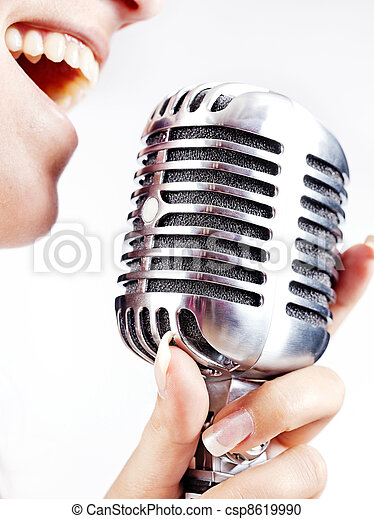 woman singing on retro microphone - csp8619990
