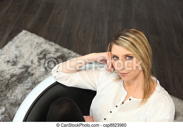 Woman sitting in a chair - csp8823960