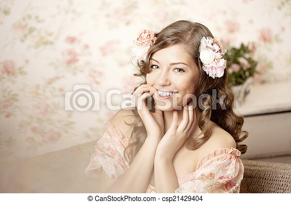 Woman sitting in a room with a vintage interior - csp21429404