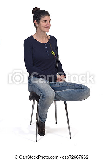 woman sitting in a vintage chair isolated on white - csp72667962