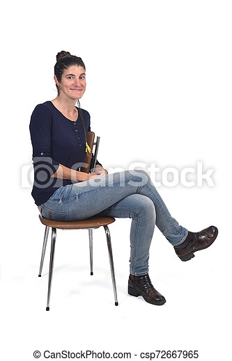 woman sitting in a vintage chair isolated on white - csp72667965