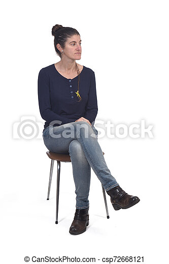 woman sitting in a vintage chair isolated on white - csp72668121