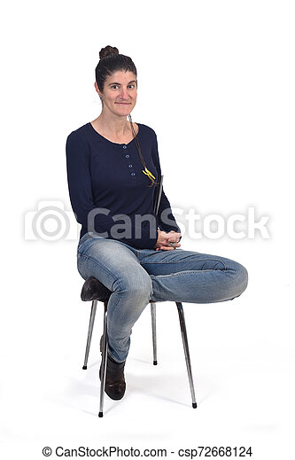 woman sitting in a vintage chair isolated on white - csp72668124