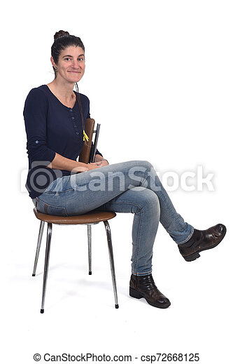 woman sitting in a vintage chair isolated on white - csp72668125