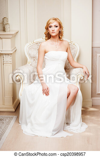 woman sitting in chair - csp20398957