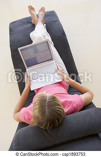 Woman sitting in chair using laptop - csp1893753