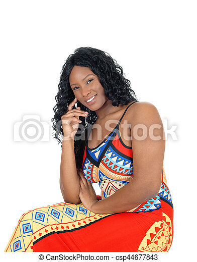 Woman sitting in colorful dress. - csp44677843