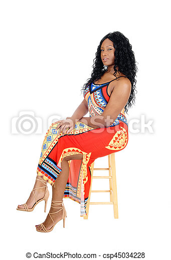 Woman sitting in colorful dress. - csp45034228