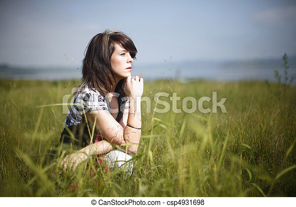 Woman sitting in the grass - csp4931698