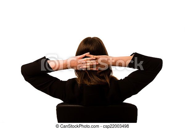 Woman sitting on a chair in office - csp22003498