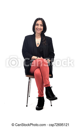 woman sitting on a chair isolated on white - csp72695121