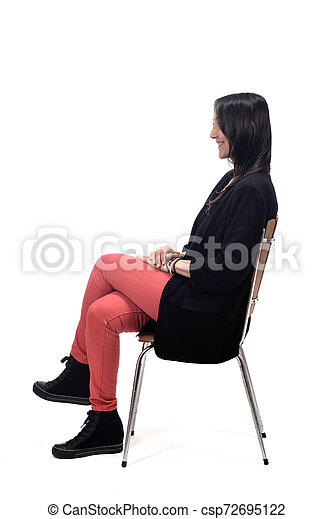 woman sitting on a chair isolated on white - csp72695122