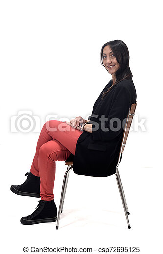 woman sitting on a chair isolated on white - csp72695125