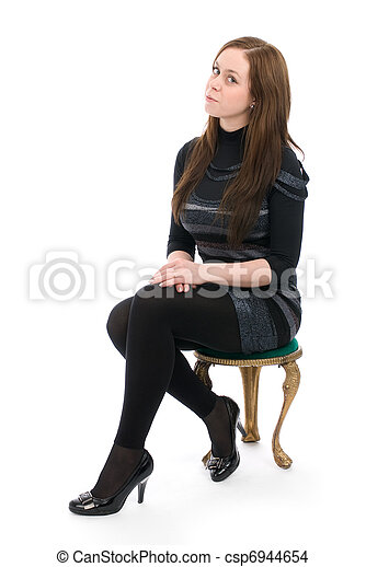 woman sitting on a chair isolated over a white background - csp6944654
