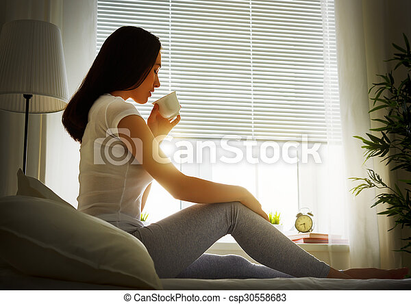 woman sitting on bed - csp30558683