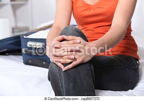 woman sitting on bed - csp8807370