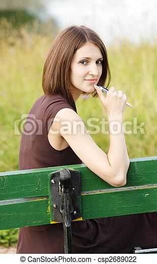 Woman sitting on bench - csp2689022
