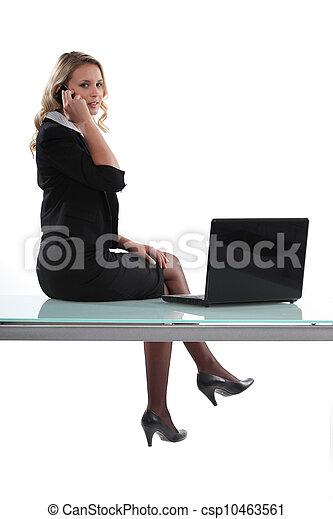 Woman sitting on her desk - csp10463561