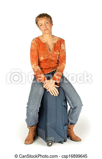 Woman sitting on her suitcase - csp16899645