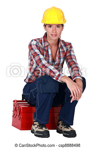 Woman sitting on her toolbox - csp8888498