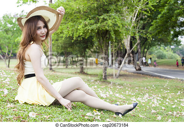 Woman sitting on lawn - csp20673184