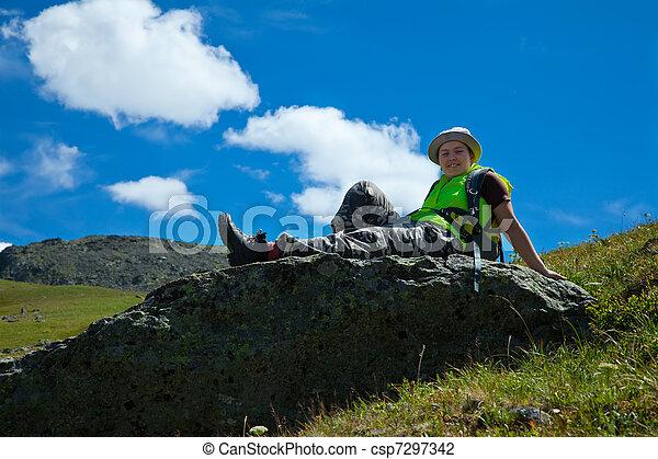 Woman sitting on mountain peak - csp7297342