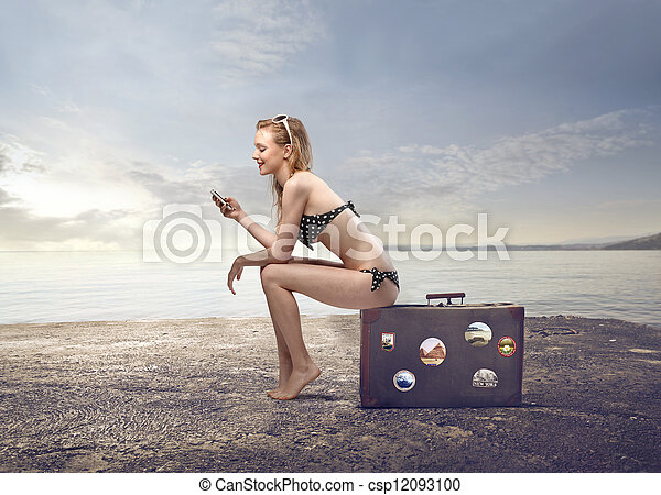 Woman sitting on suitcase - csp12093100