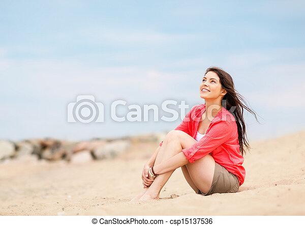 woman sitting on the beach - csp15137536