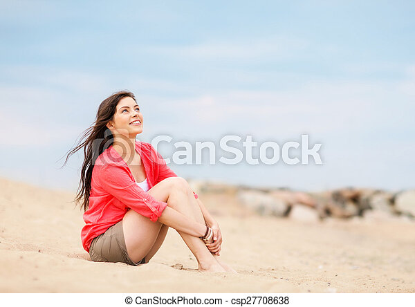 woman sitting on the beach - csp27708638