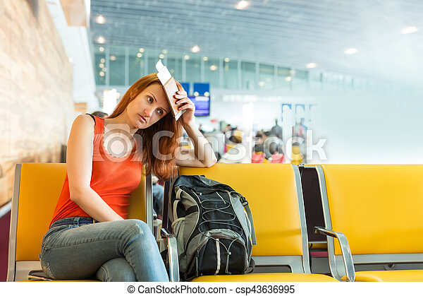 Woman sitting on the chair in a station hall. - csp43636995