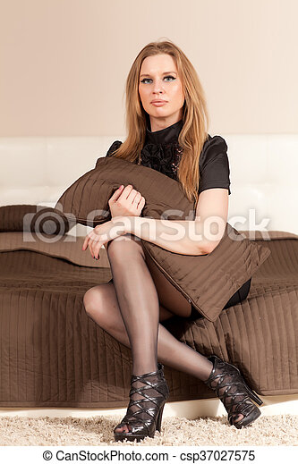 Woman sitting on the couch - csp37027575