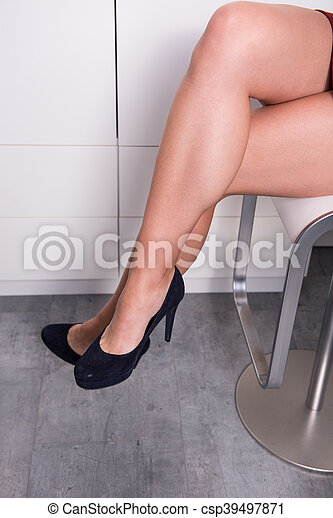 woman sitting with crossed legs on a chair in the office - csp39497871