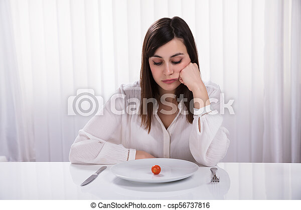 Woman Sitting With Plate Of Cherry Tomato - csp56737816