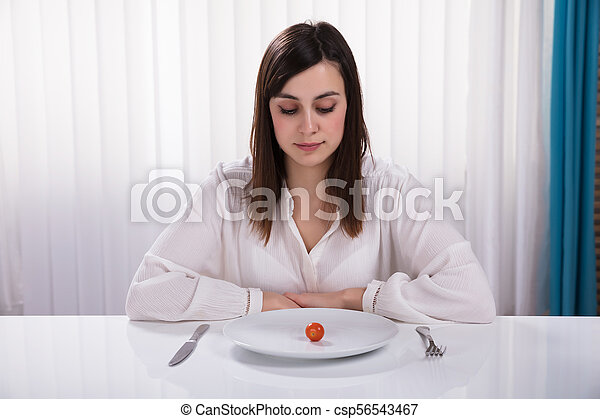 Woman Sitting With Plate Of Cherry Tomato - csp56543467