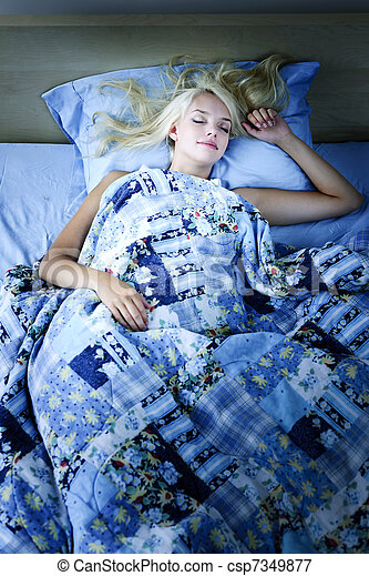 Woman sleeping in bed at night - csp7349877