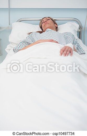 Woman sleeping on a bed - csp10497734