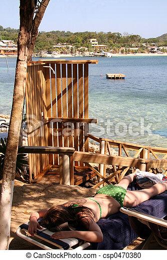Woman Sleeping on Beach - csp0470380