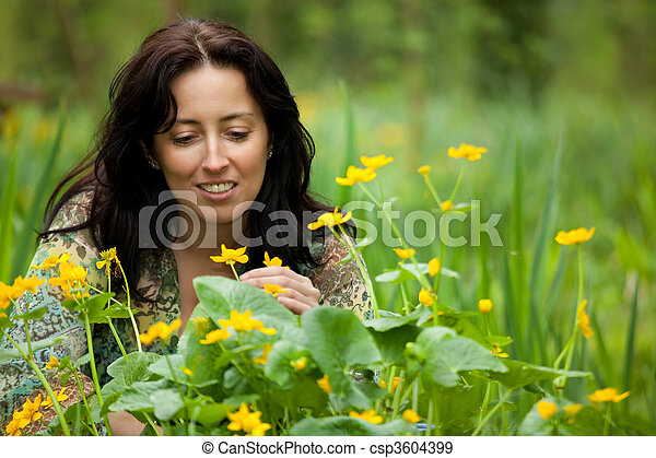 woman smelling flower - csp3604399