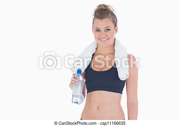Woman smiling while holding a bottle of water - csp11166635
