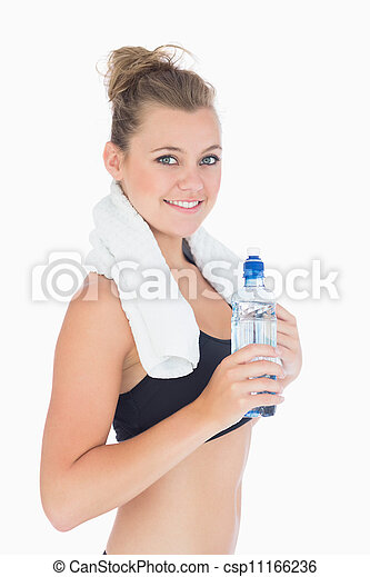 Woman smiling while holding a bottle - csp11166236