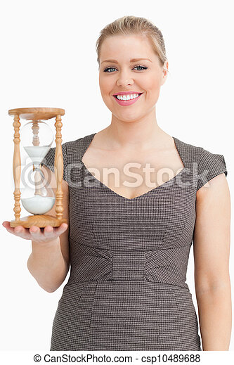 Woman smiling while holding a hourglass - csp10489688