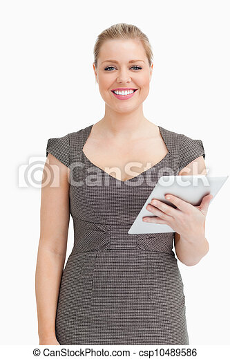 Woman smiling while using an ebook - csp10489586