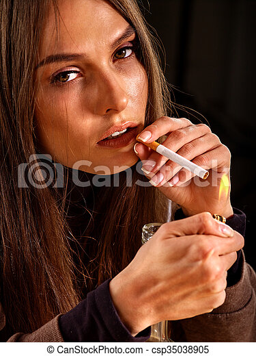 Woman smokes cigarette. - csp35038905