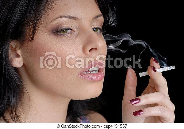woman smoking on black background - csp4151557