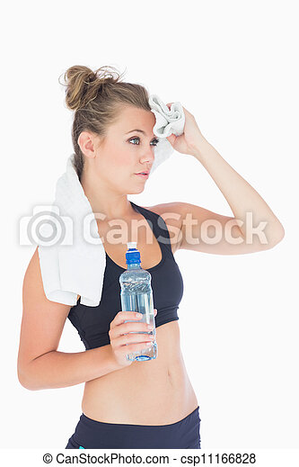 Woman standing holding a bottle of water and a white towel  - csp11166828