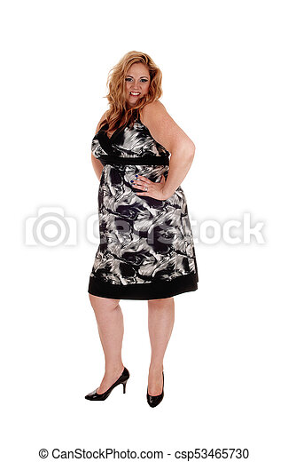 Woman standing in dress, smiling - csp53465730